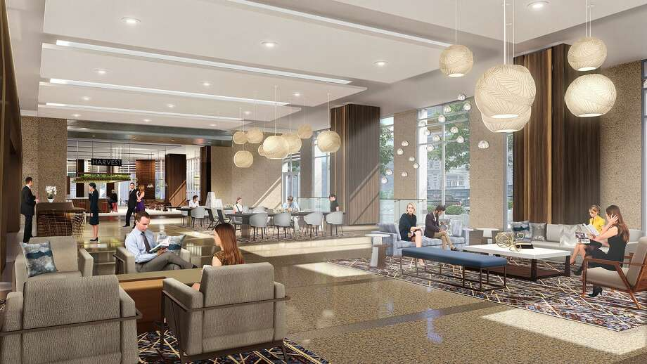 Renovations of the lobby at 717 Texas in downtown Houston are under way. A rendering shows new seating areas, furniture and lighting. Photo: Hines