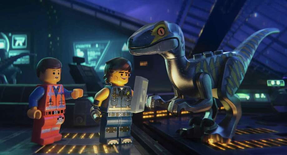 "This image released by Warner Bros. Pictures shows the characters Emmet, left, and Rex Dangervest, center, both voiced by Chris Pratt, in a scene from ""The Lego Movie 2: The Second Part."" (Warner Bros. Pictures via AP) Photo: Associated Press / Warner Bros. Pictures"