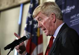 Former Massachusetts Gov. William Weld gestures during a New England Council 'Politics & Eggs' breakfast in Bedford, N.H., Friday, Feb. 15, 2019. Weld announced he's creating a presidential exploratory committee for a run in the 2020 election. (AP Photo/Charles Krupa)
