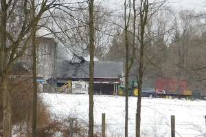 Firefighters battled a barn fire on the property of Clatter Hill Farm in New Milford on the morning of Friday, Feb. 15, 2019. Clatter Hill Farm is a Community Supported Agriculture Farm that allows people to purchase memberships for a weekly supply of produce.