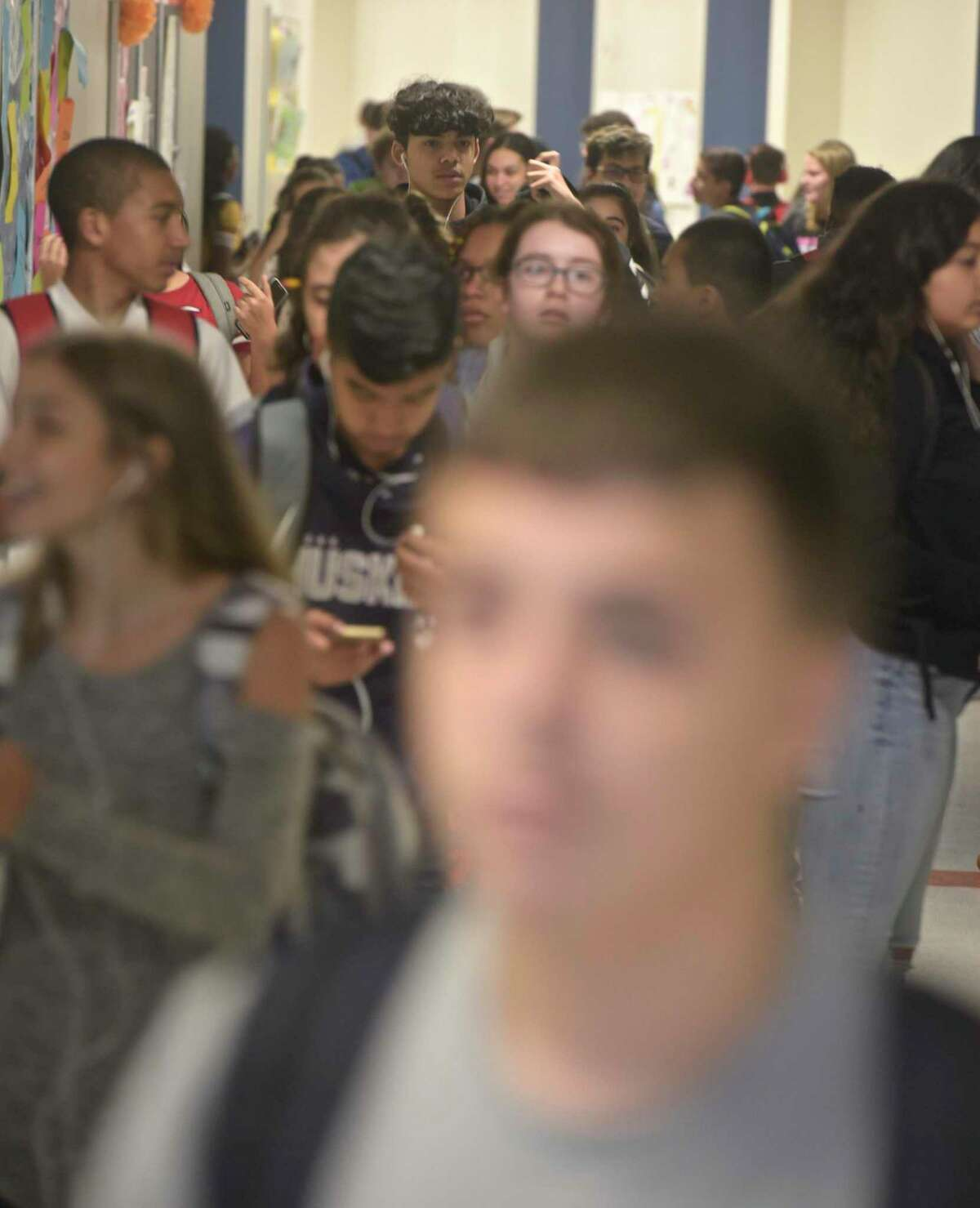 Students fill the hallway of the new addition at Danbury High School between classes on Wednesday, October 10, 2018, in Danbury, Conn.