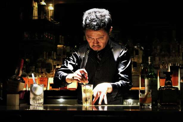 At Apollo Bar in Tokyo, Hidenori Komatsu's highball preparation involves dancelike grace and precision, under a spotlight, with Tom Waits songs playing on repeat. Komatsu is shown Nov. 20, 2018.