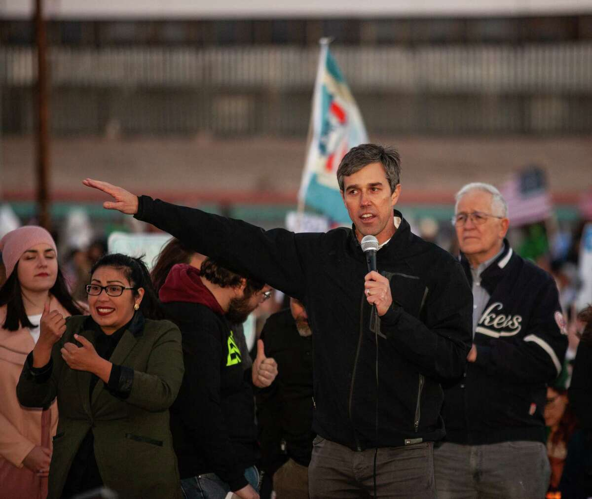 With the border wall in El Paso behind him Beto O'Rourke speaks at a rally Feb. 11, 2019. O'Rourke on Thursday said that if he had the choice, he'd tear out the barrier separating El Paso from Ciudad Juarez, Mexico.