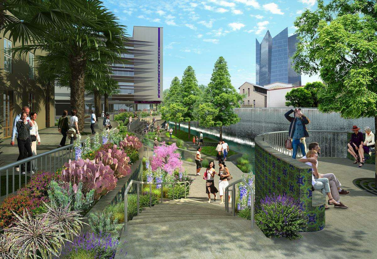The second segment of the San Pedro Culture Creek will include a serene green space with a 250-foot cascading wall of water, as shown in this rendering, depicting the view looking north toward Houston Street.