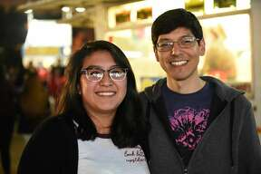 Lizbeth Resendiz Santiago and Joaquin Al pose for a photo during the WBCA Carnival's Opening Day.