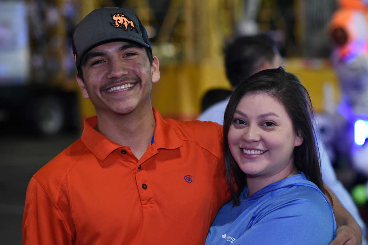 Juan Moreno and Jasmine Juno pose for a photo during the WBCA Carnival's Opening Day.