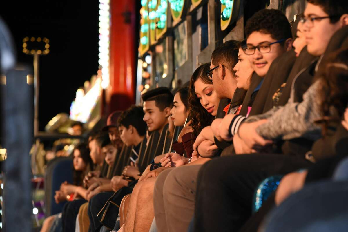 Families and couples spent Valentine's Day eating, playing and enjoying the rides at the WBCA Carnival during its opening day at the Sames Auto Arena, Thursday, February 14, 2019.
