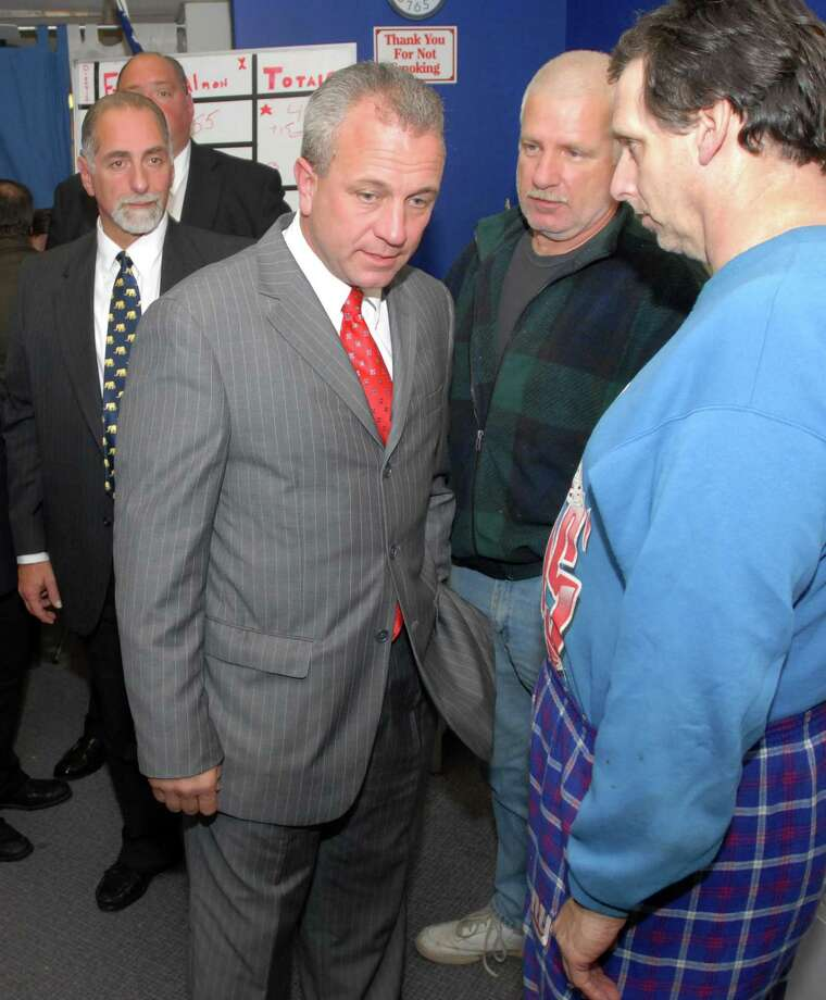 John Finkle, former Republican candidate for East Haven mayor, among supporters after his loss to April Capone Almon in this file photo. Photo: File Photo
