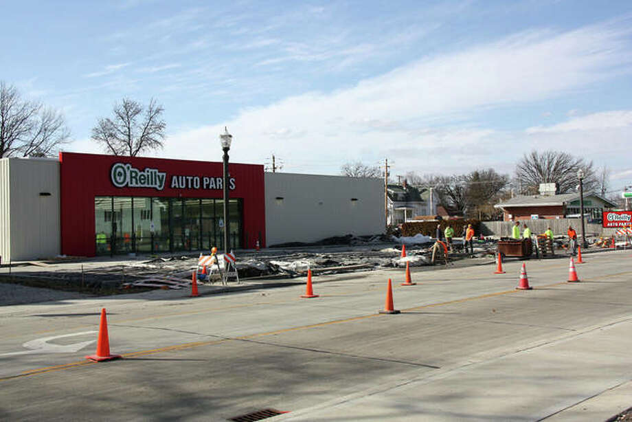 Construction workers put the finishing touches on the site of a new O'Reilly Auto Parts store Thursday in Edwardsville at 301 Buchanan St., immediately south of a BP gas station. City officials estimate the store will open in early March. Photo: Charles Bolinger | The Intelligencer