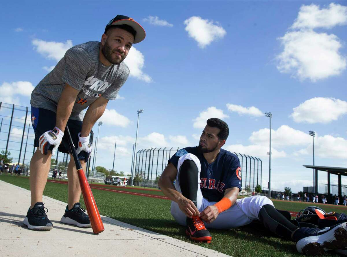 Houston Astros second baseman Jose Altuve (27) talks to catcher Robinson Chirinos (28) when Chirinos is changing shoes at Fitteam Ballpark of The Palm Beaches on Day 2 of spring training on Friday, Feb. 15, 2019, in West Palm Beach.