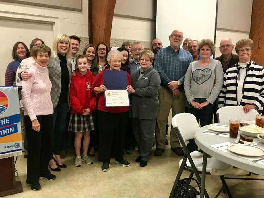 Lillie Wilson is surrounded by family, coworkers and Rotary members when she was recently surprised with special recognition for her 67 years of volunteer work in the kitchen of Peace United Church of Christ. Photo: For The Intelligencer