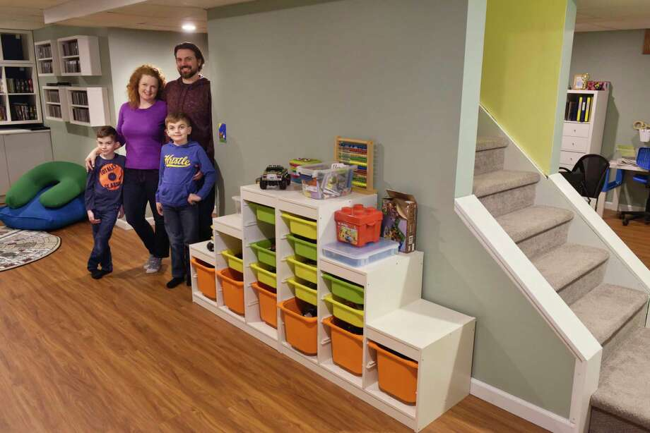 Leigh Hornbeck and her husband, Josh Trombley pose for a photo in their finished basement with their two sons, Devlin Trombley, 6, left, and Rushton Trombley, 9, on Tuesday, Feb. 12, 2019, in Gansevoort, N.Y.   (Paul Buckowski/Times Union) Photo: Paul Buckowski / (Paul Buckowski/Times Union)
