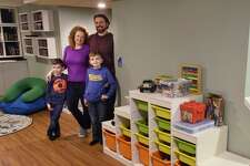 Leigh Hornbeck and her husband, Josh Trombley pose for a photo in their finished basement with their two sons, Devlin Trombley, 6, left, and Rushton Trombley, 9, on Tuesday, Feb. 12, 2019, in Gansevoort, N.Y. (Paul Buckowski/Times Union)