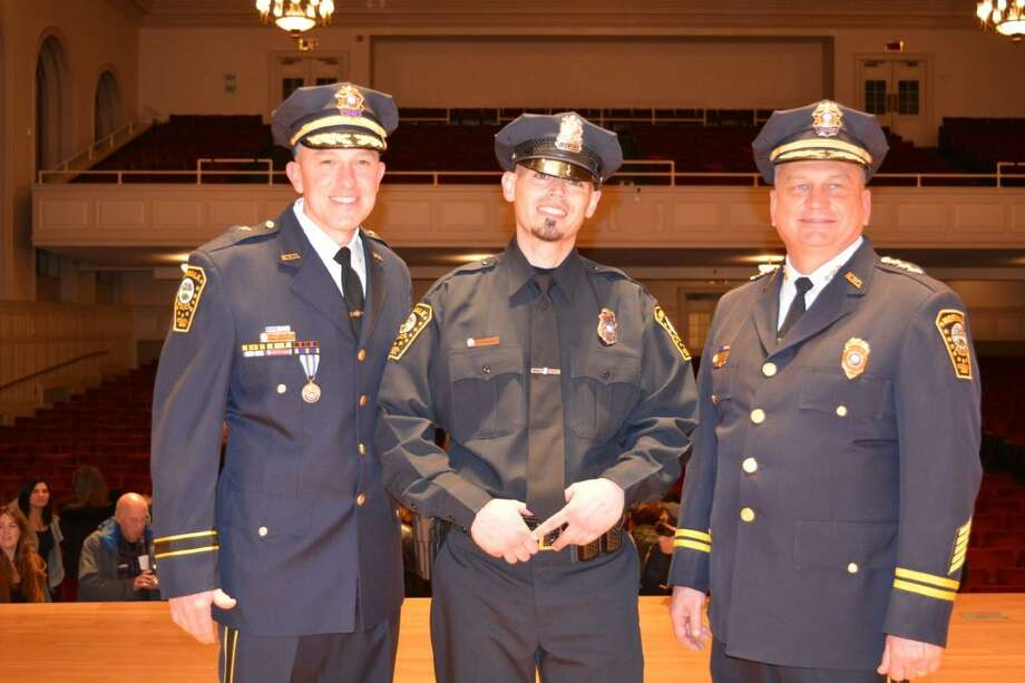 """Norwalk's """"Officer of the Year"""" Jose Rodriguez is shown between Deputy Chief James Walsh (left) and Police Chief Tom Kulhawik (right). Photo: Contributed Photo"""