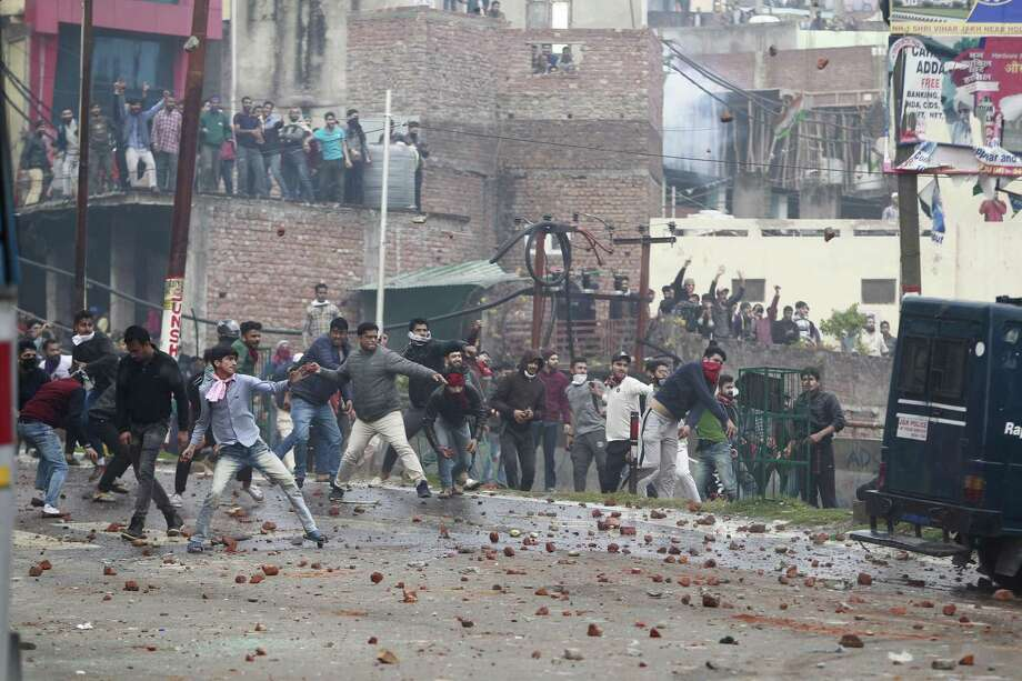 Protesters in Hindu-dominated Jammu city throw stones during a clash between communities over an attack that killed 40 Indian soldiers in the Muslim-majority state of Kashmir. Photo: Channi Anand / Associated Press / Copyright 2019 The Associated Press. All rights reserved.