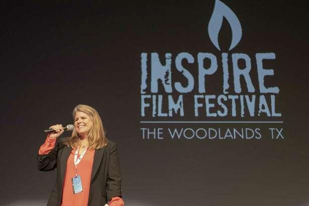 Inspire Film Festival founder Jane Minarovic addresses a crowd during the Inspire Film Festival on Thursday, Feb. 14, 2019 in The Woodlands.