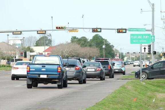 Traffic backs up at the intersection of FM 518 and Pearland Parkway in Pearland, where police recently increased their presence in an effort to cut down on accidents caused by traffic violations.