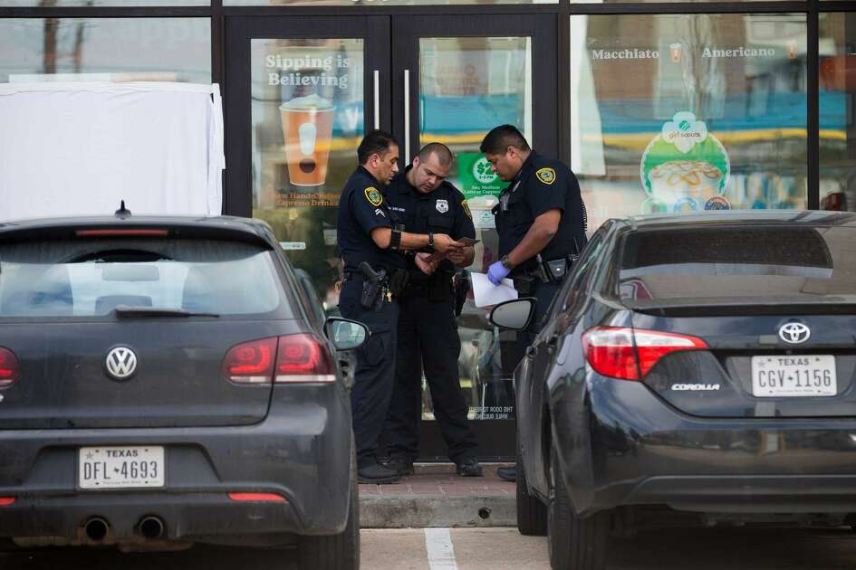 Houston police investigate an apparent murder-suicide at Dunkin' Donuts in the 5800 block of Memorial Drive at Birdsall Street on Friday, Feb. 15, 2019.