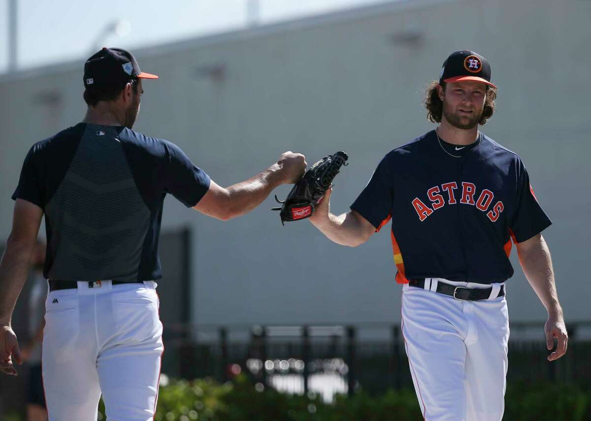 Houston Astros right handed pitchers Justin Verlander, left, and Gerrit Cole do a fist bump after training on Day 2 of spring training at Fitteam Ballpark of The Palm Beaches on Friday, Feb. 15, 2019, in West Palm Beach.