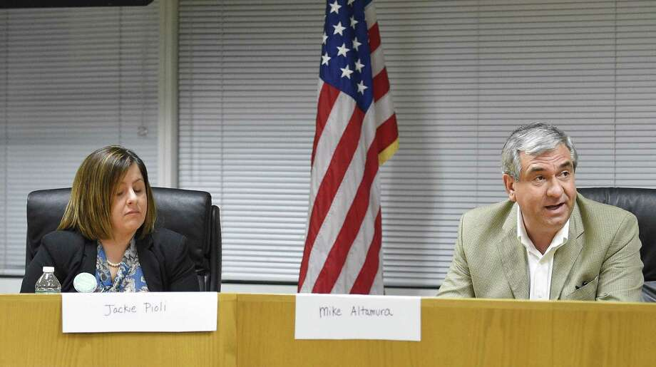 Members of the Stamford Board of Education, including Jackie Pioli (L) and Mike Altamura (R) voted on the school board budget for the 2019-2020 school year on Feb. 14, 2019 in Stamford, Conn. Photo: Matthew Brown / Hearst Connecticut Media / Stamford Advocate