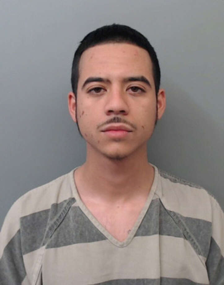 Gilberto Bautista, 24, was charged with aggravated assault on a peace officer with a vehicle, evading arrest with a vehicle and smuggling of persons. Photo: Webb County Sheriff's Office