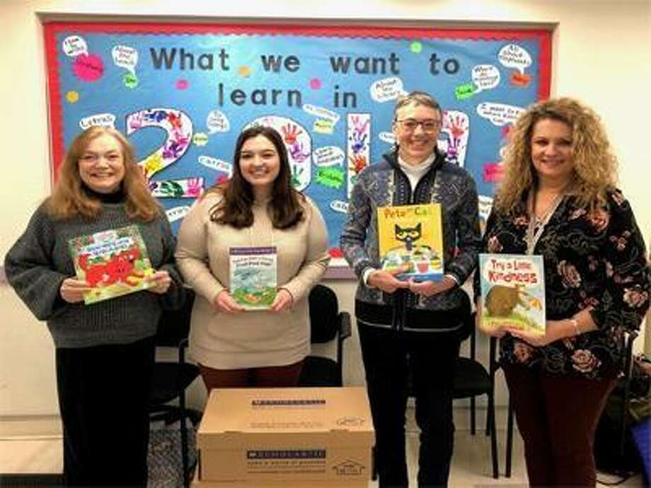 Preschool children have 725 new books to read this year thanks to a book drive with Immaculate High School students and volunteer coordinator Sally Kile; Morgan Greening, special projects coordinator at United Way of Western Connecticut; volunteer coordinator Sandy Rankin; and Sondra Cherney, assistant education manager at Connecticut Institute for Communities' Early Learning Programs. Photo: Contributed Photo / United Way Of Western Connecticut