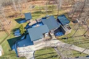 New Houston football coach Dana Holgorsen has listed his West Virginia mansion for $2.95 million.
