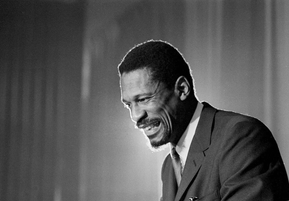 Bill Russell grins at announcement that he had been named coach of the Boston Celtics basketball team, April 18, 1966. Russell, 32, former University of San Francisco star becomes first black coach in National Basketball Association history. (AP Photo)