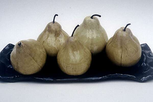Works by the late artist Lois Eldrige include her famous pears.