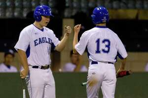 New Caney's Blain Elliott (13) gets a fist-bump from Carlos Robles (16) during a game last season. Both return to the Eagles in 2019.