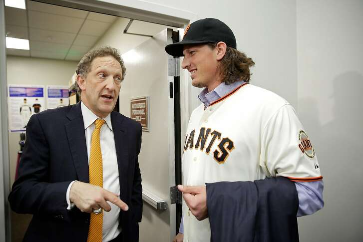 San Francisco Giants pitcher Jeff Samardzija, right, listens to team president and CEO Larry Baer, left, following a news conference Friday, Dec. 11, 2015, in San Francisco. The Giants introduced right-hander Samardzija, who signed a $90 million, five-year deal. (AP Photo/Eric Risberg)