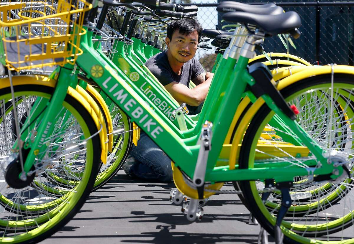 Brad Bao, co-founder and chairman of Lime Bike, is seen with a fleet of bicycles in San Mateo, Calif. on Tuesday, July 11, 2017. Lime Bike hopes to deploy as many as 3,000 of its undocked and station-less bike-share bicycles on the streets of San Francisco as soon as the permitting process is completed.