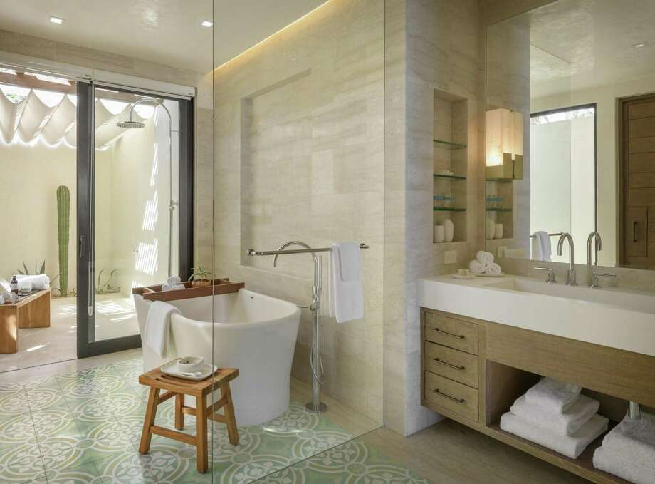 San Francisco-based BAMO designed this villa's spa bathroom at the Auberge Chileno Bay Resort in Los Cabos, Mexico. The indulgent space blends contemporary hardware against an encaustic tile floor and includes a soaking tub and outdoor shower. Photo: Aaron Leitz Photography / © 2018 Aaron Leitz Photography