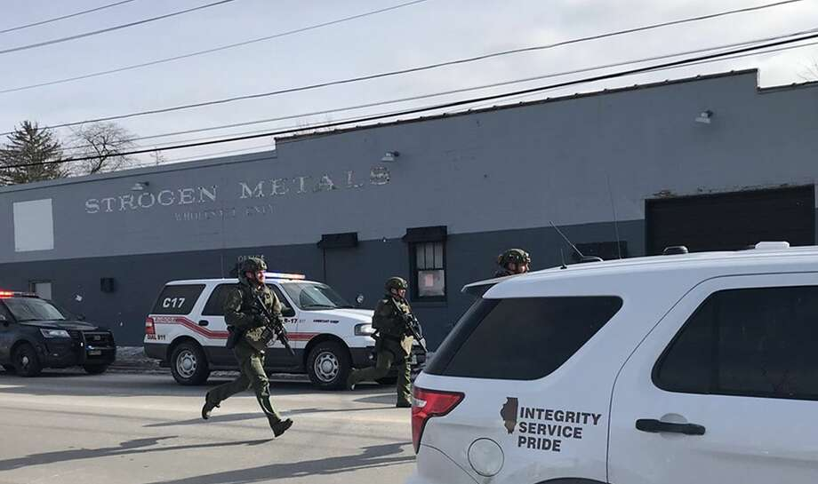 The scene in Aurora, photographed by Beacon News crime reporter Megan Jones, of the on-going possible active shooter. Dozens of area police officers have responded to the situation, and there are many injuries, according to Kendall County Dispatch. (Megan Jones/Beacon News/TNS) Photo: Megan Jones/TNS