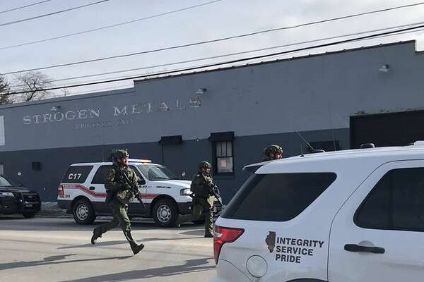 The scene in Aurora, photographed by Beacon News crime reporter Megan Jones, of the on-going possible active shooter. Dozens of area police officers have responded to the situation, and there are many injuries, according to Kendall County Dispatch. (Megan Jones/Beacon News/TNS)