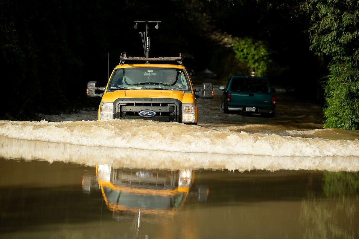A truck creates a bow wave while fording flood waters on Neeley Rd. on Friday, Feb. 15, 2019. The Russian River overflowed its banks swamping some streets before waters started to recede Friday morning.