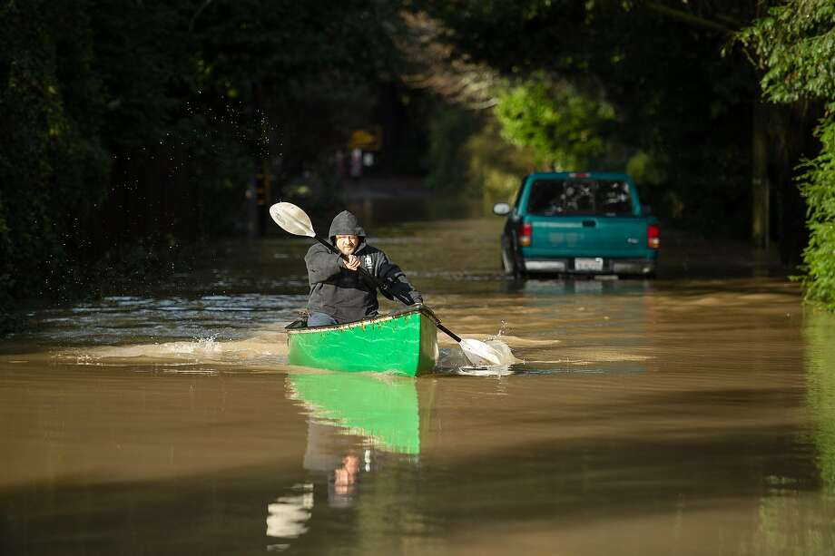 Sean O'Connor canoes through floodwaters on Neeley Rd. on Friday, Feb. 15, 2019. The Russian River overflowed its banks flooding some streets before waters started to recede Friday morning. Photo: Noah Berger / Special To The Chronicle