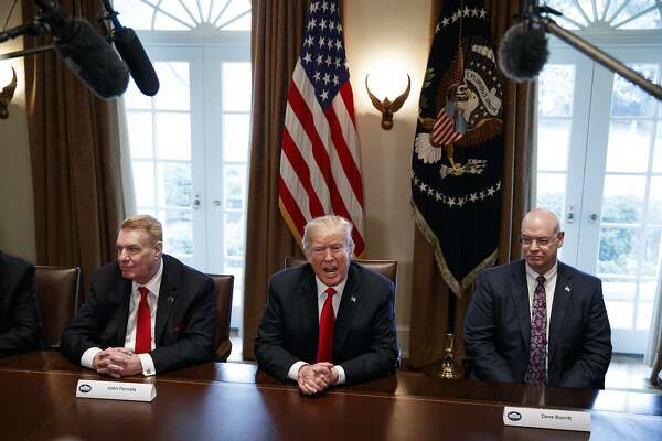 FILE - In this March 1, 2018, file photo, President Donald Trump speaks during a meeting with steel and aluminum executives in the Cabinet Room of the White House in Washington, with Nucor's John Ferriola, left, and Dave Burritt of U.S. Steel Corporation. Hundreds of companies have been granted permission to import millions of tons of steel made in China, Japan and other countries without paying the hefty tariff Trump put in place. (AP Photo/Evan Vucci, File)
