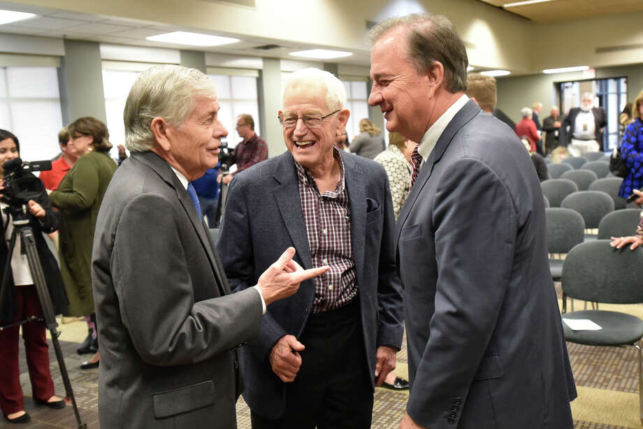 State Rep. Tom Craddick, from left, oilman Jim Henry, and John Sharp, chancellor of the Texas A&M University system, talk Feb. 14 following an announcement about the Texas A&M-Concho Engineering Academy. Henry received the Top Pioneer Award from the Permian Basin Petroleum Pioneers Friday at the Petroleum Club. Photo: James Durbin / ? 2019 Midland Reporter-Telegram. All Rights Reserved.
