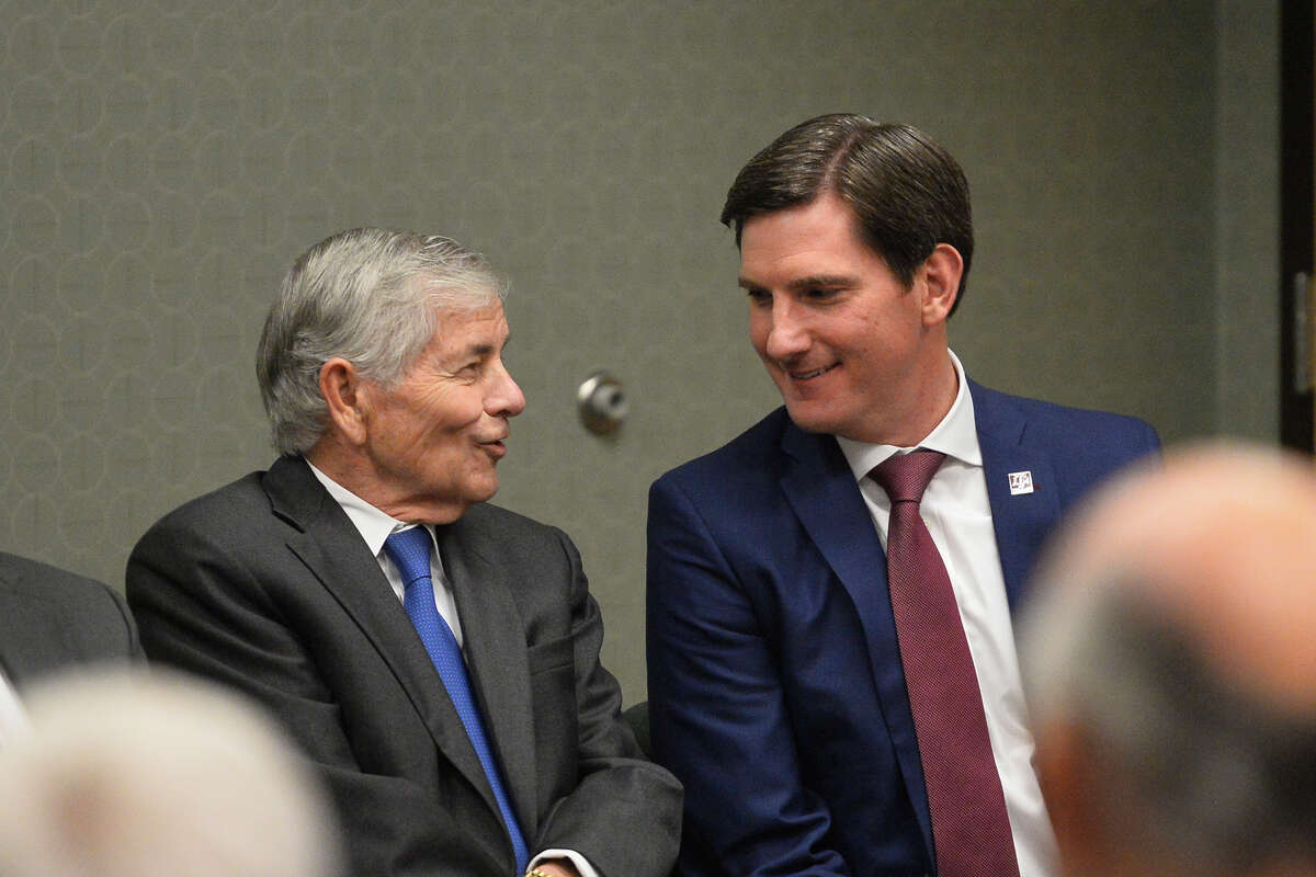State Representatives from left, Tom Craddick and Brooks Landgraf, chat during an announcement about the Texas A&M-Concho Engineering Academy, Feb. 14, 2019, in the Carrasco Room at Midland College.