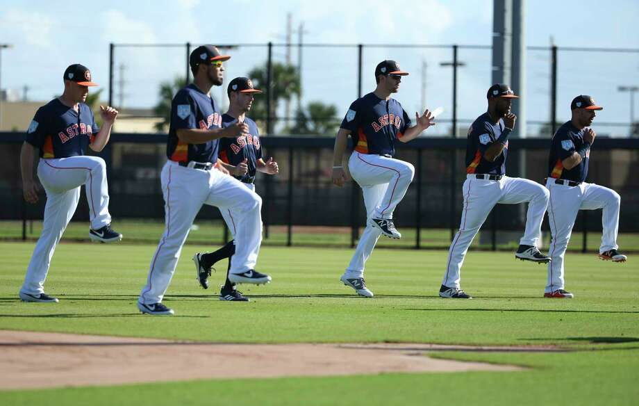 Houston Astros catchers stretch at Fitteam Ballpark of The Palm Beaches on Day 2 of spring training on Friday, Feb. 15, 2019, in West Palm Beach. Photo: Yi-Chin Lee, Houston Chronicle / © 2019 Houston Chronicle