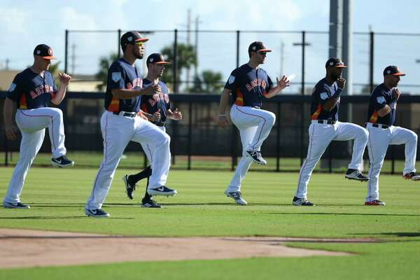 Houston Astros catchers stretch at Fitteam Ballpark of The Palm Beaches on Day 2 of spring training on Friday, Feb. 15, 2019, in West Palm Beach.