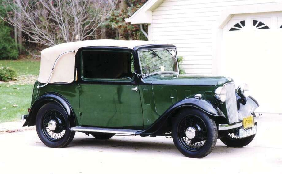 While working for the U.S. State Department some 20 years ago, Melvin Gamble was assigned to South Africa. While attending an auction to find artwork for his new house, a cute little 1935 Austin with 54-spoke wire wheels caught his eye. (Motor Matters photo)