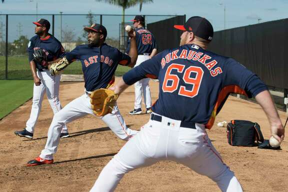Houston Astros pitchers J.B. Bukauskas (69), from front, Reymin Guduan (64), Josh James (39) and Forrest Whitley (68) pitch at bullpen at Fitteam Ballpark of The Palm Beaches on Day 2 of spring training on Friday, Feb. 15, 2019, in West Palm Beach.