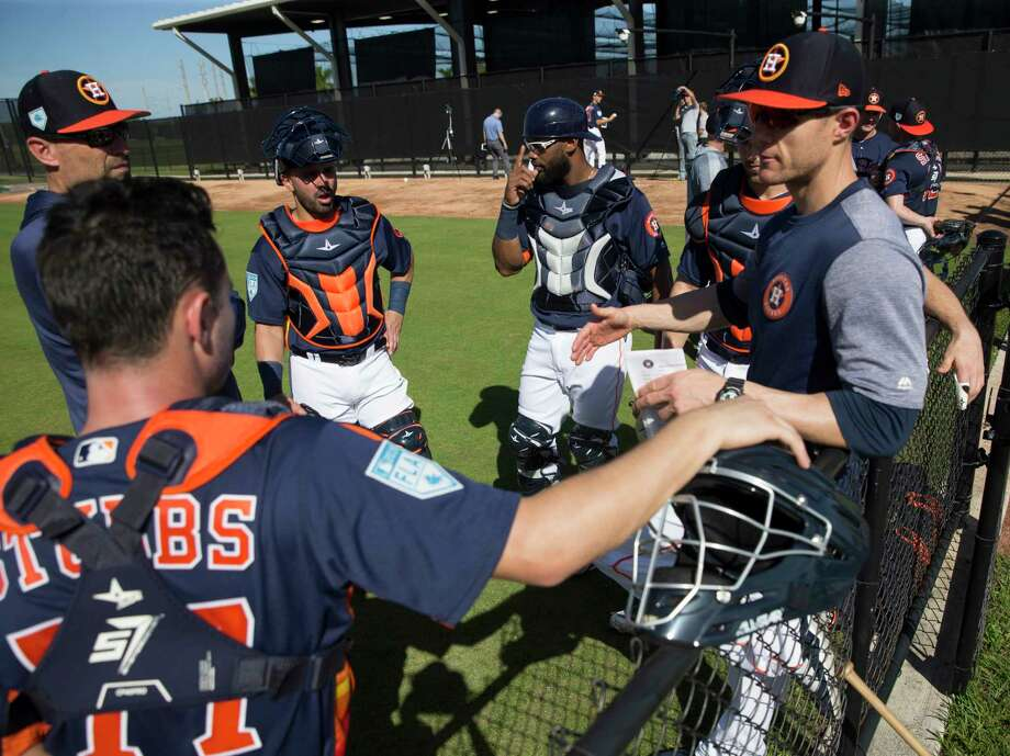 Houston Astros catchers Garrett Stubbs, from left, Lorenzo Quintana, Chuckie Robinson and Jamie Ritchie talk to minor league catching coordinator Mark Bailey, left, and catching coach Michael Collins during practice at Fitteam Ballpark of The Palm Beaches on Day 2 of spring training on Friday, Feb. 15, 2019, in West Palm Beach. Photo: Yi-Chin Lee, Houston Chronicle / © 2019 Houston Chronicle