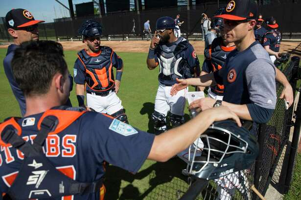 Houston Astros catchers Garrett Stubbs, from left, Lorenzo Quintana, Chuckie Robinson and Jamie Ritchie talk to minor league catching coordinator Mark Bailey, left, and catching coach Michael Collins during practice at Fitteam Ballpark of The Palm Beaches on Day 2 of spring training on Friday, Feb. 15, 2019, in West Palm Beach.