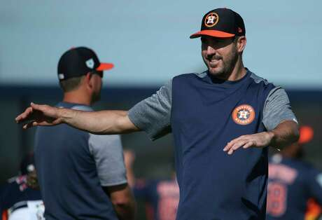 Houston Astros right handed pitcher Justin Verlander (35) stretches at Fitteam Ballpark of The Palm Beaches on Day 2 of spring training on Friday, Feb. 15, 2019, in West Palm Beach.
