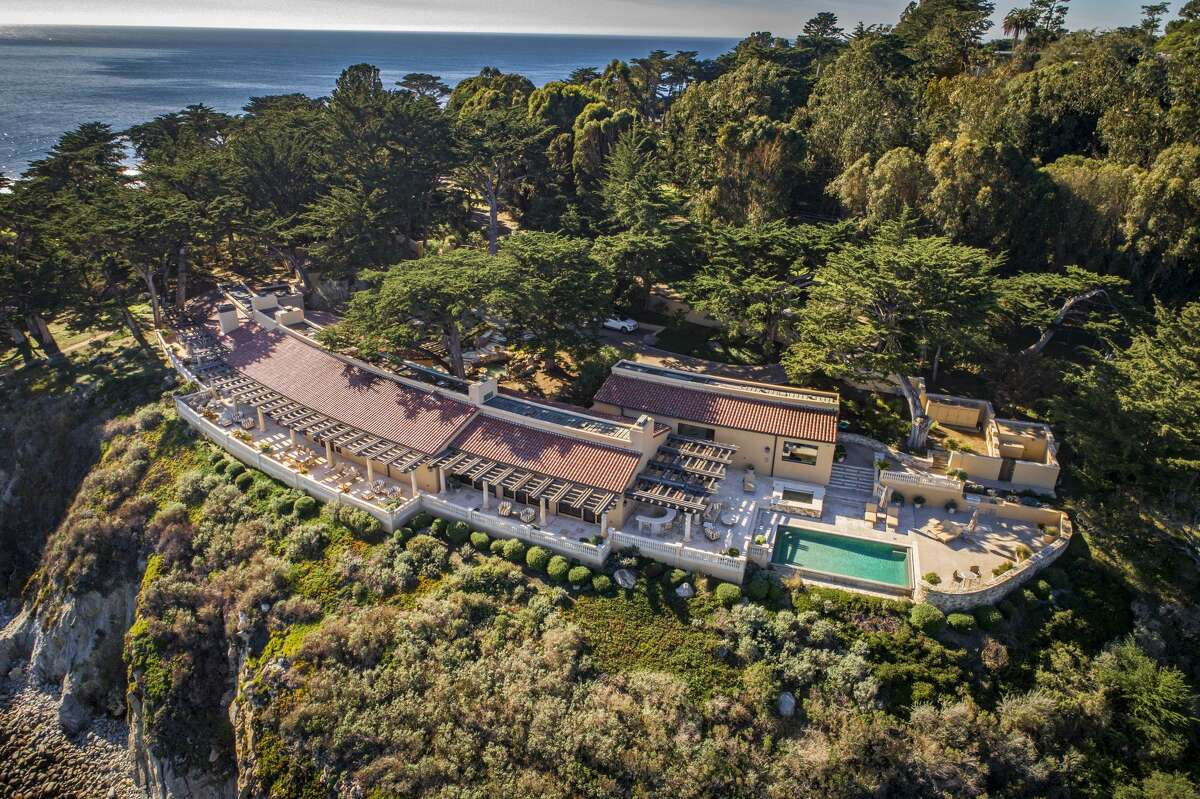Amid cypress trees on the cliffs of Pescadero Point, 3290 17 Mile Drive is one of 31 waterfront properties in Pebble Beach.