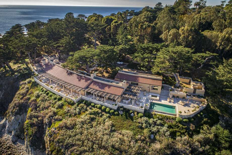 Amid cypress trees on the cliffs of Pescadero Point, 3290 17 Mile Drive is one of 31 waterfront properties in Pebble Beach. Photo: Straightline Images