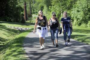 From left, sisters Susan White, of Brookfield, Patti Giddings of New Milford and Bonnie Saumell of Danbury, go for a morning walk together on the Still River Greenway Friday, June 2, 2017.